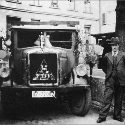 Andreas Schmid, the company founder, in front of his first vehicles